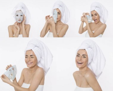 Funny beautiful woman with a cosmetic mask on her face and with a towel on her head. Facial skin care after bathroom shower.