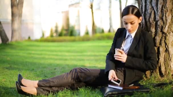 Confident thinking business woman relax and drinking coffee in the park during work break and answer on phone call