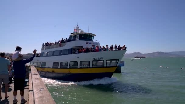 San Francisco, California, USA - August 2019: Tourists departing from Fishermans Wharf on a boat tour to Alcatraz Island