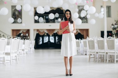 Business woman with folder restaurant menu.