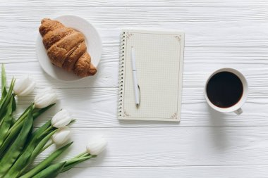 tulips with coffee and Notepad
