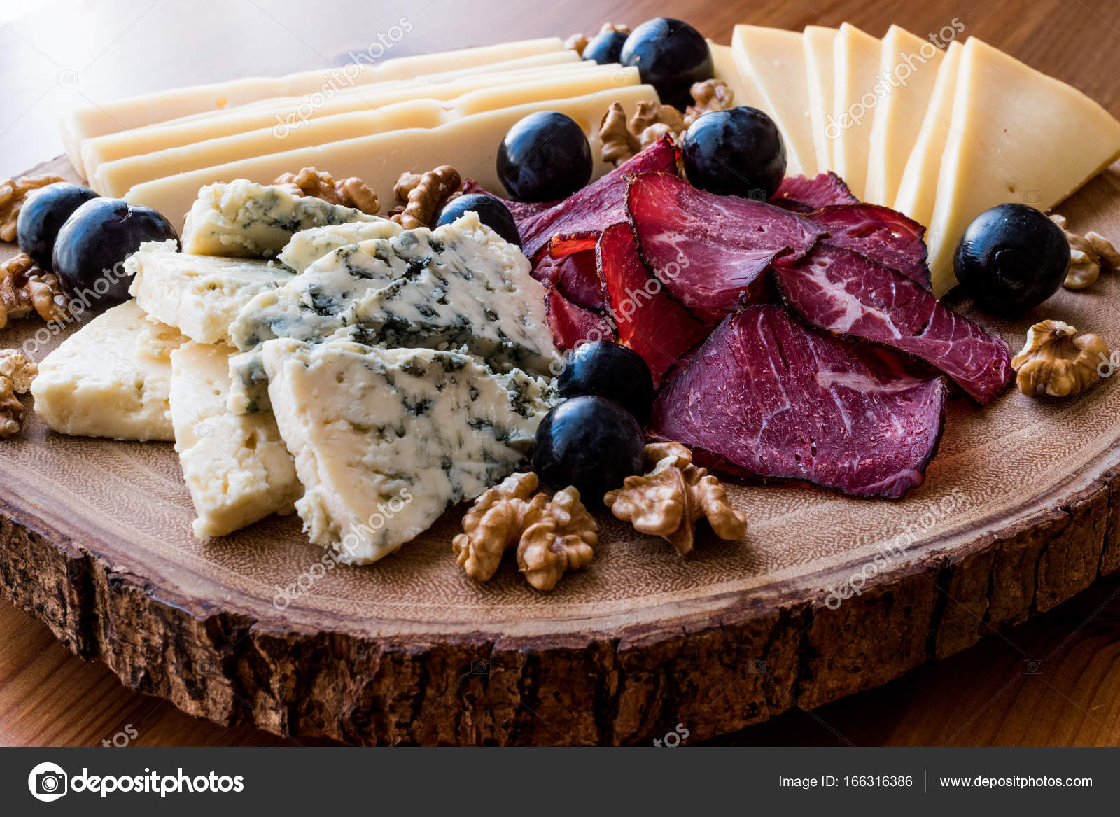 Cheese Plate with smoked meat walnuts and grapes on wooden surface u2014 Stock Photo & Cheese Plate with smoked meat walnuts and grapes on wooden surface ...