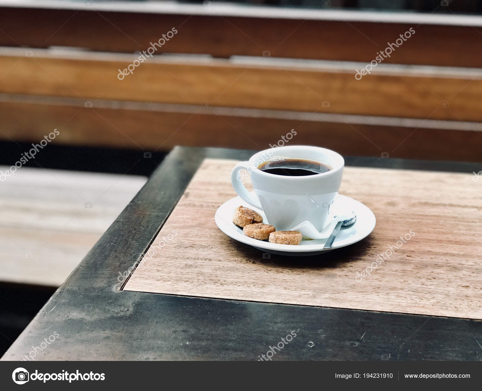 Fresh Filter Filtered Coffee With Bubbles And Small Cookies At Kopi Street Stock Photo