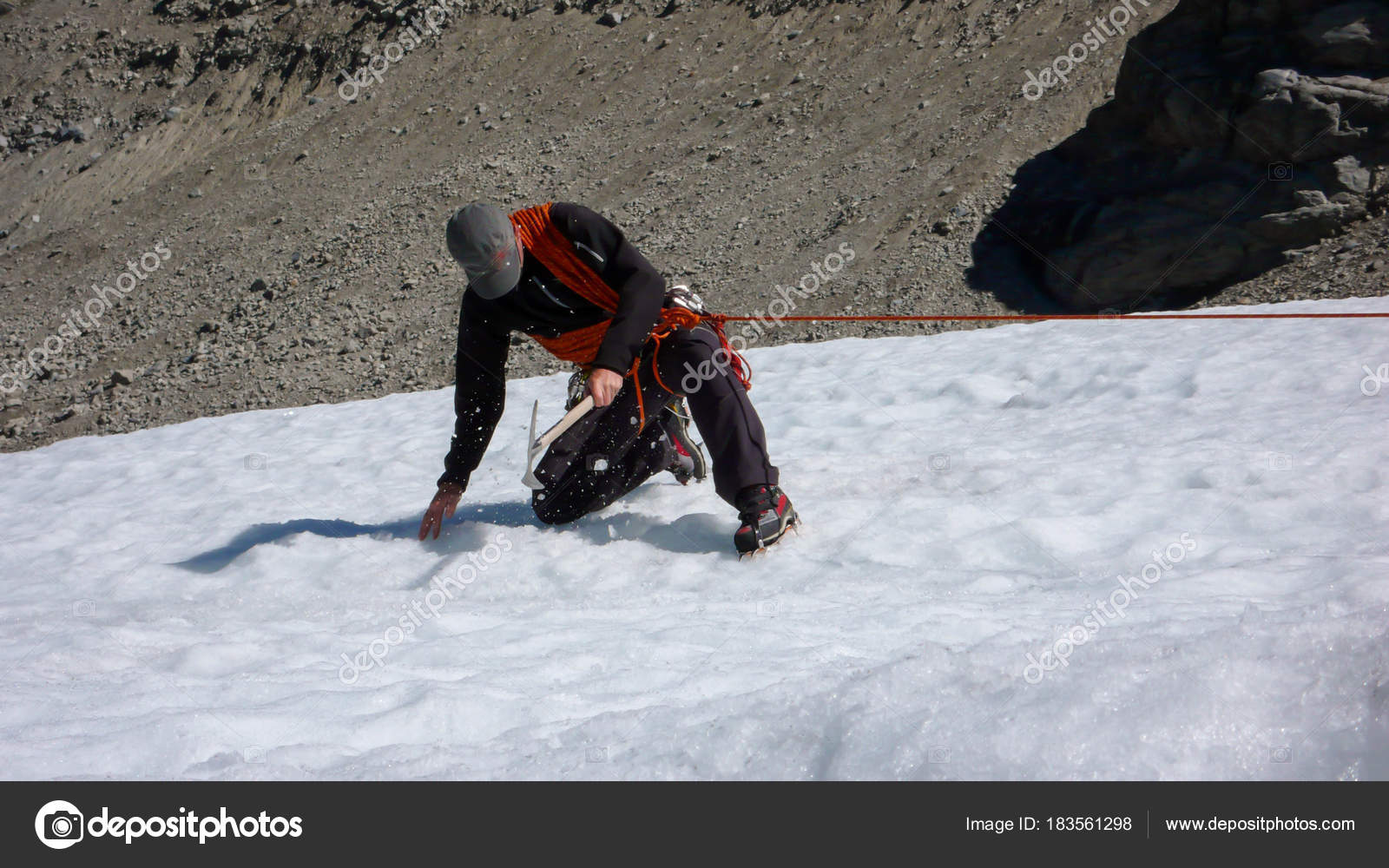 One Male Mountain Guide Installing Pulley System Crevasse