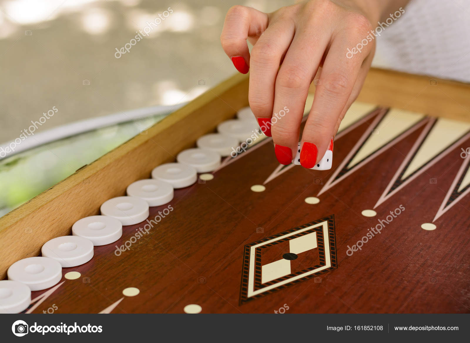 backgammon bone square white dice for gambling with blurred ...