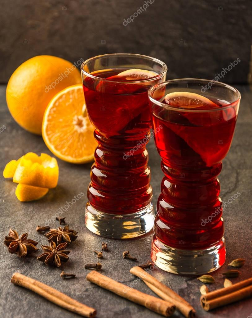 mulled wine with cinnamon sticks and oranges