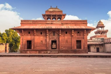 Red sandstone fort and palace at Fatehpur Sikri Agra. Fatehpur Sikri fort and city showcases Mughal architecture in India.