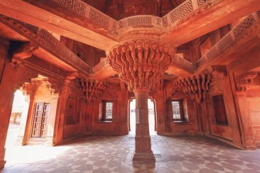 Fatehpur Sikri Agra red sandstone architecture details of pillar structure with lotus top inside Diwan-i-khas which bears the heritage of Mughal India architecture at Agra, India