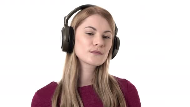 Beautiful woman with headphones listens to music on smartwatch. Sending kiss with hand. Isolated.