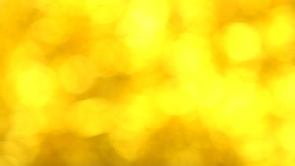 Absztrakt Defocused homályos csillogó arany Bokeh. Karácsonyi. Új év. Ünnepe