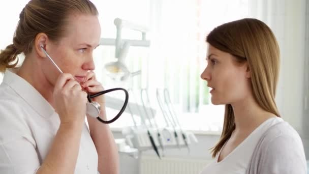 Female professional doctor at work. Woman physician using stethoscope for listening patients lungs