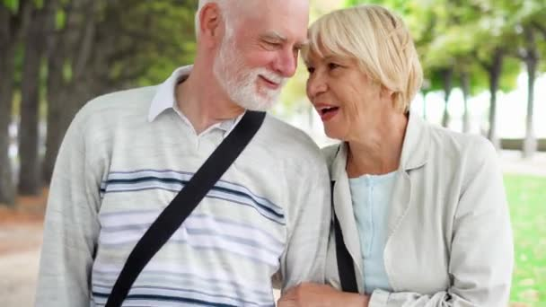 Senior couple walking in park. Active modern life after retirement. Family enjoying time together