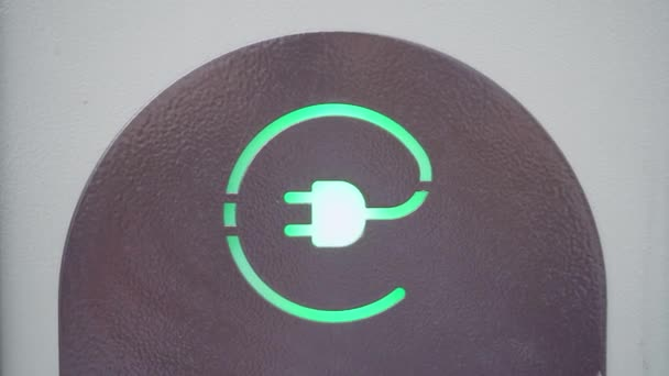 Green sign of power socket for electric cars. Concept of eco friendly resources preservation