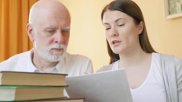 Teacher giving lesson to senior student. Female tutor explaining foreign language rule to senior man