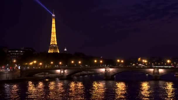 PARIS, FRANCE- CIRCA August 2017: Searchlight on top of famous french landmark Eiffel Tower at night
