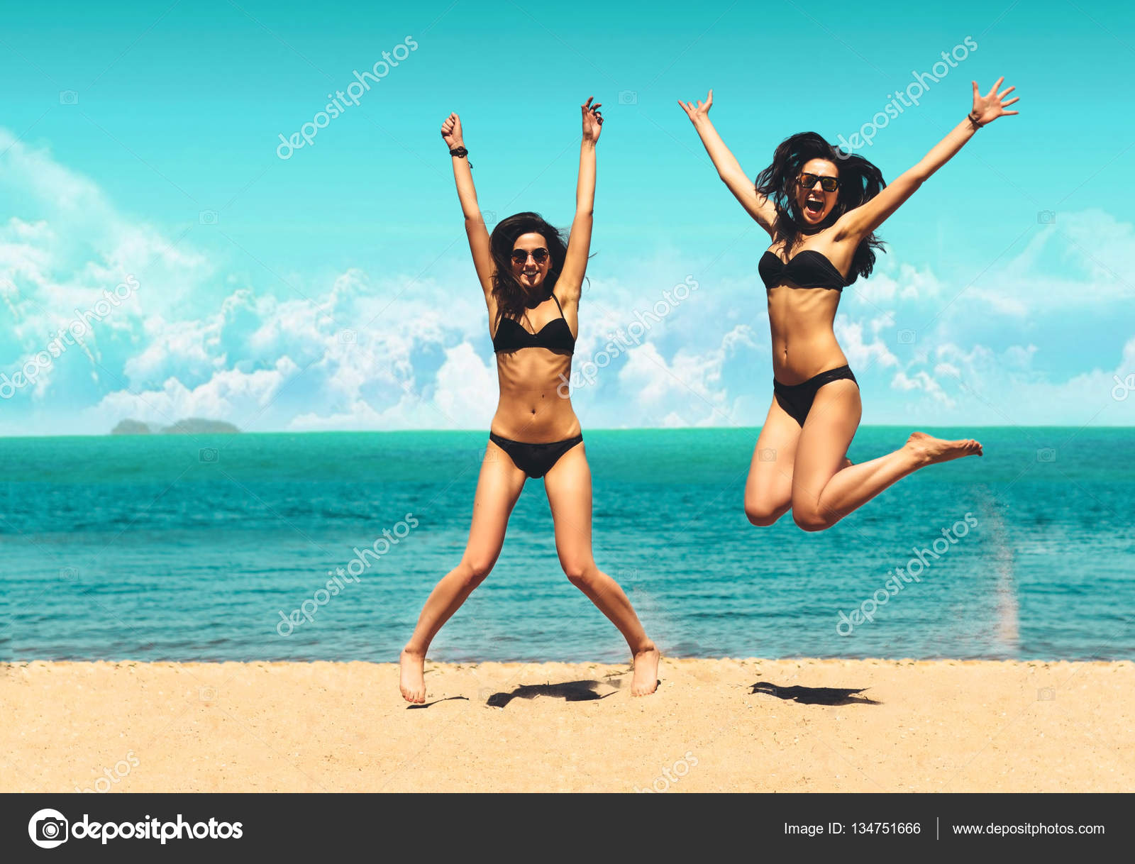 Two Attractive Girls In Bikinis Jumping On The Beach Best Friends Having Fun Summer Vacation Holiday Lifestyle Happy Women Freedom White Sand