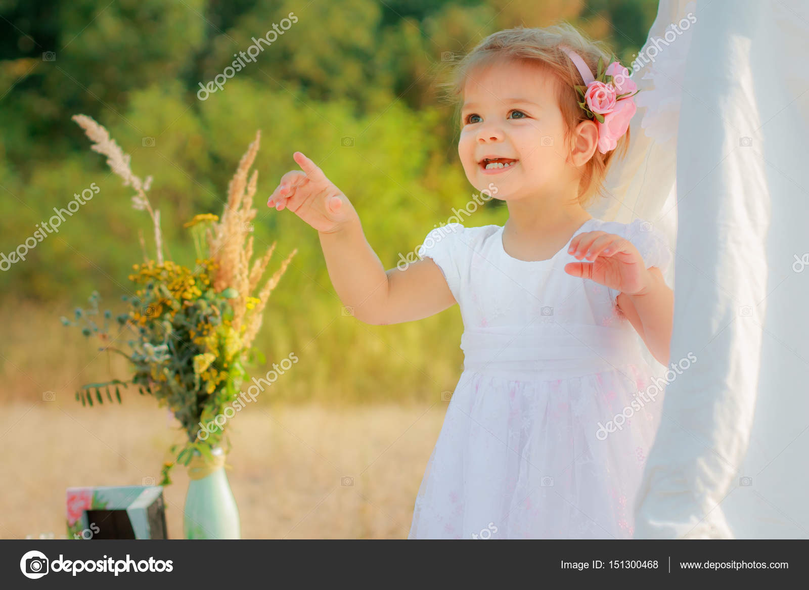 Little girl smiles and shows finger upward. A girl in a white Wigwam play tent childrens play house tent awning tent canopy parasol ...  sc 1 st  Depositphotos & Little girl smiles and shows finger upward. A girl in a white ...