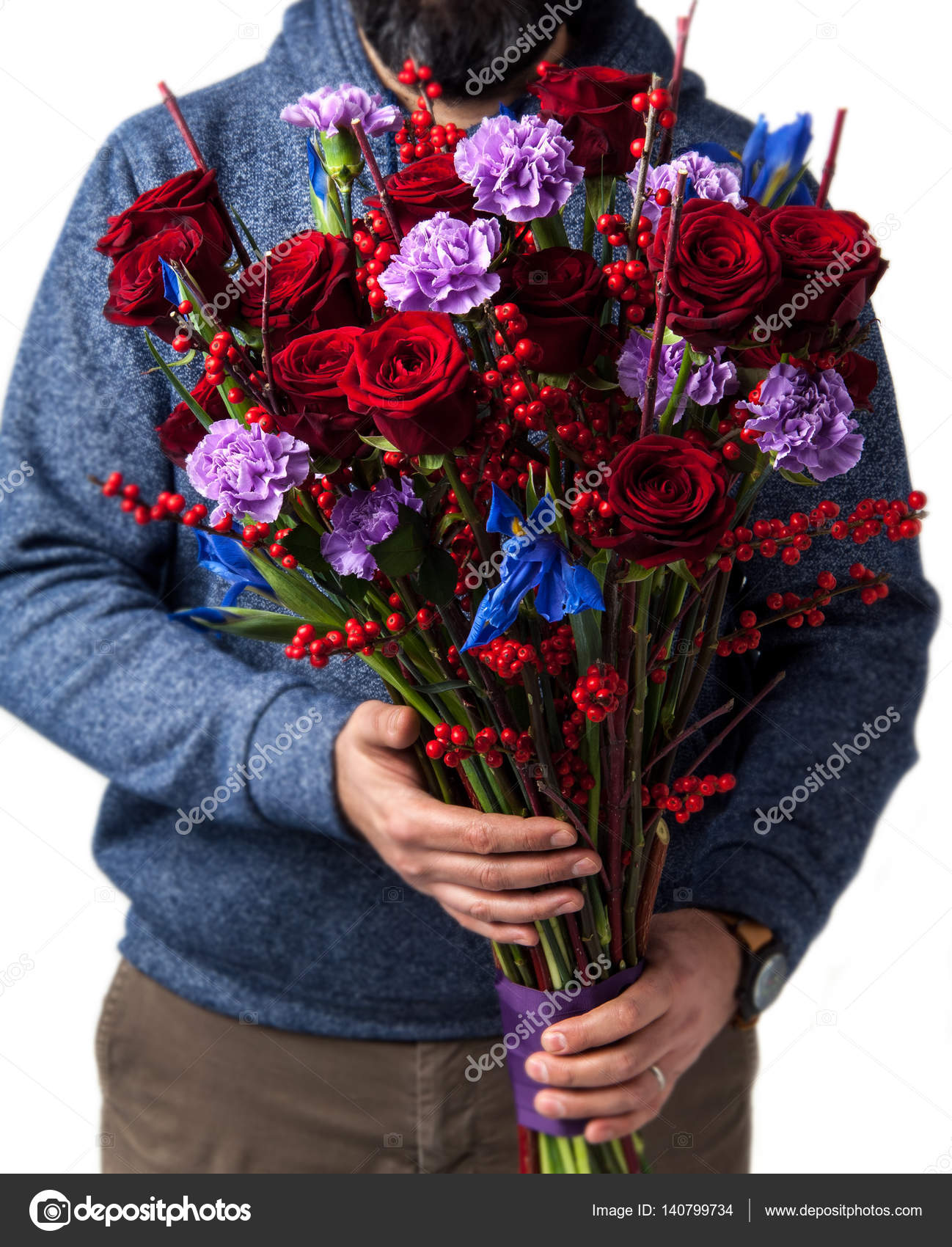 the man holding flowers in their hands — Stock Photo © WarlokA ...