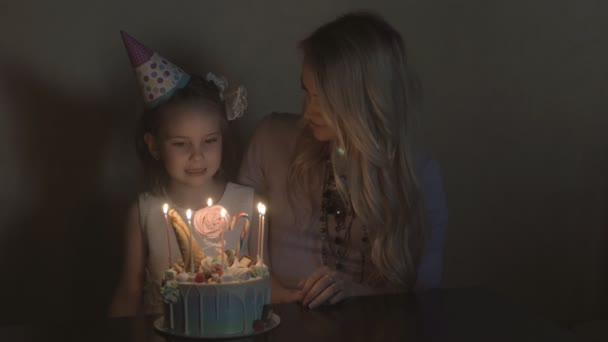childrens birthday party. birthday cake for little birthday girl. family celebration concept.