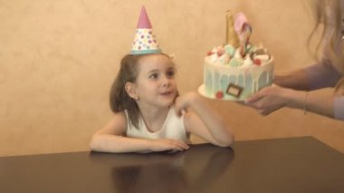 childrens birthday party. birthday cake for little birthday girl. family celebration