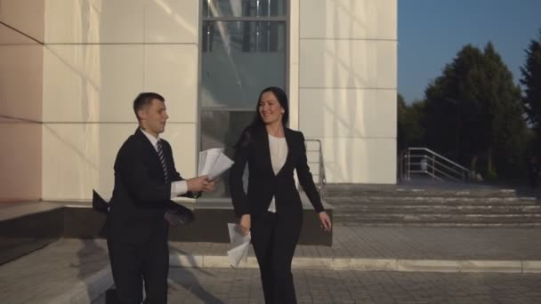 Happy businesspeople throw out documents