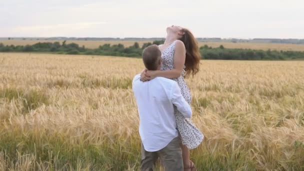 Romantic date on a wheat field, love couple hugs