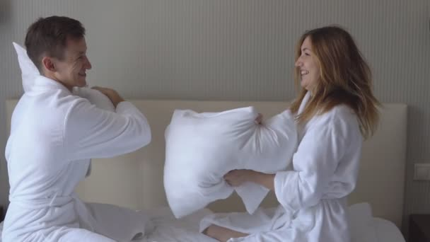 Loving couple arranges fights with pillows