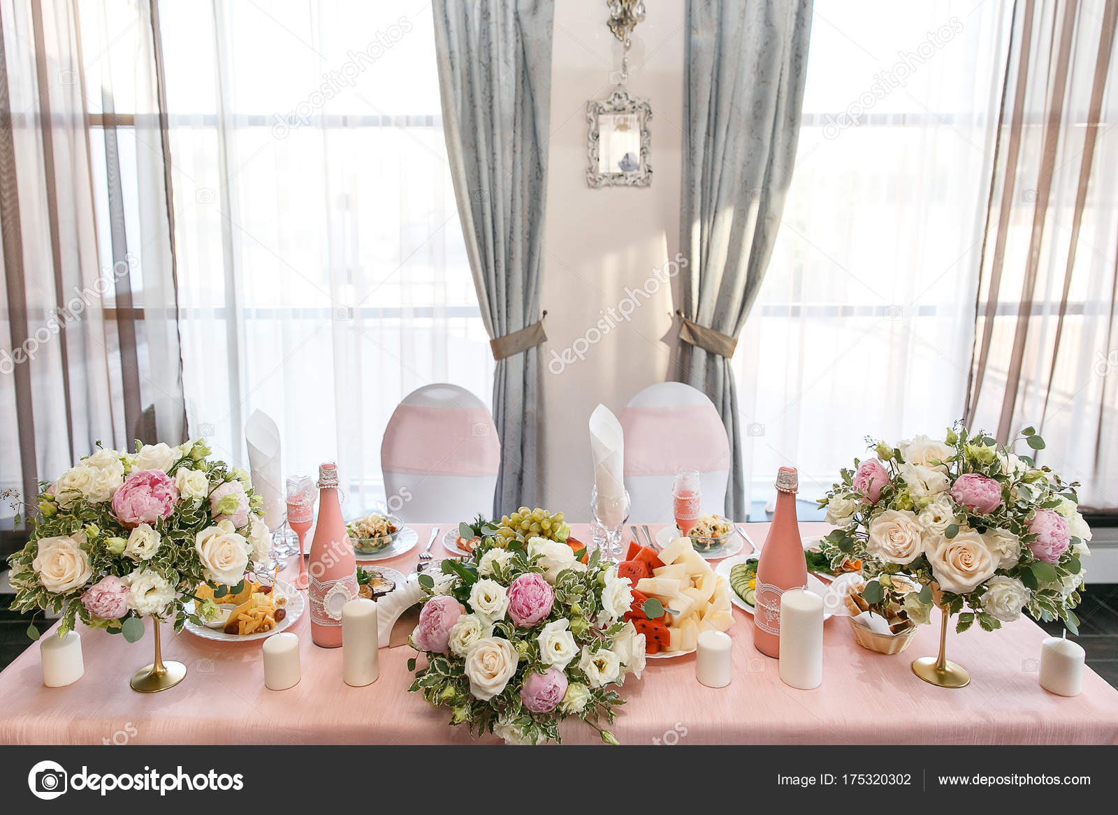 Decoration of a wedding table of newlyweds, candles, candlestick ...