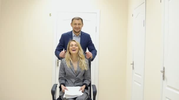 Business man and woman have fun in the office during a break.