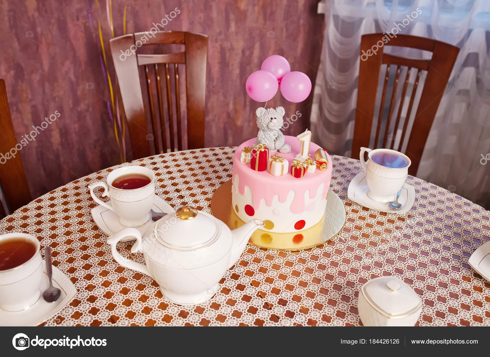Festive Tea Party Happy Birthday Cake And Cups Of Stock Photo