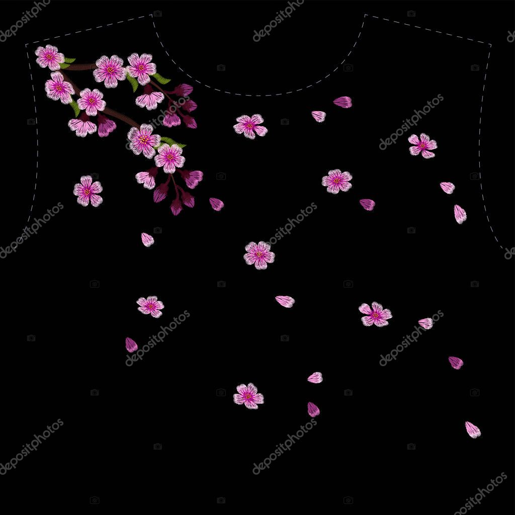 Embroidery blossoming cherry branches on a black background