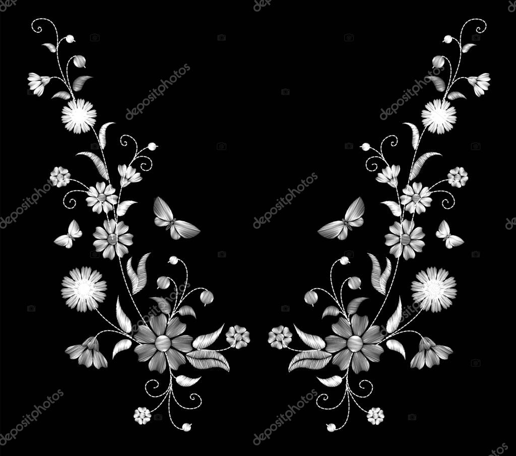 Embroidery white wild flowers on a black background