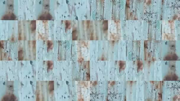 Abstract video of mosaic textures from the elements of a metal wall in green paint with rusty splashes. Background design. Backdrop. Wallpaper.