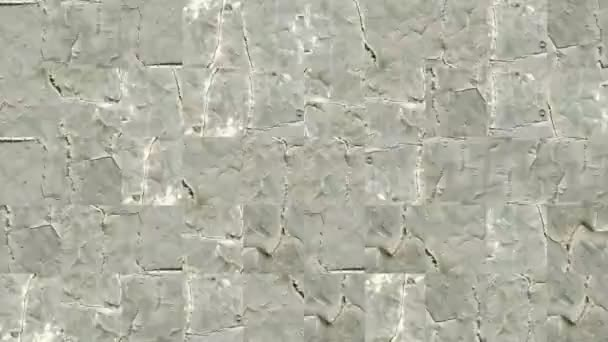 Abstract video of mosaic textures from fragments of a cement wall in pale green cracked paint. Background design. Backdrop. Wallpaper.