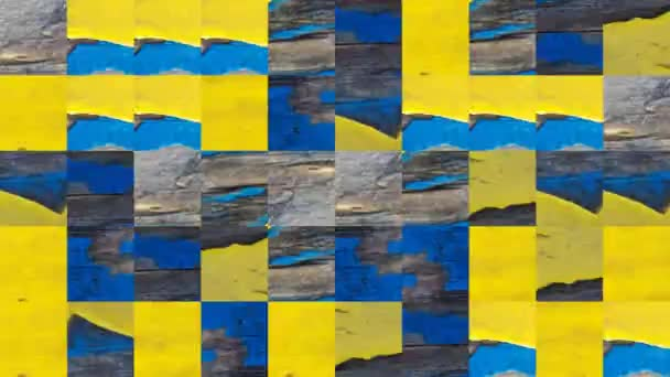 Abstract video of mosaic textures from elements of a brown old board in peeling blue yellow paint. Background design. Backdrop. Wallpaper.