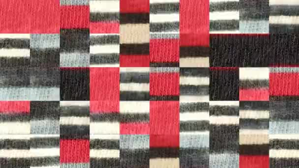 Abstract video of mosaic textures from fragments of red gray striped fabric. Background design. Backdrop. Wallpaper.