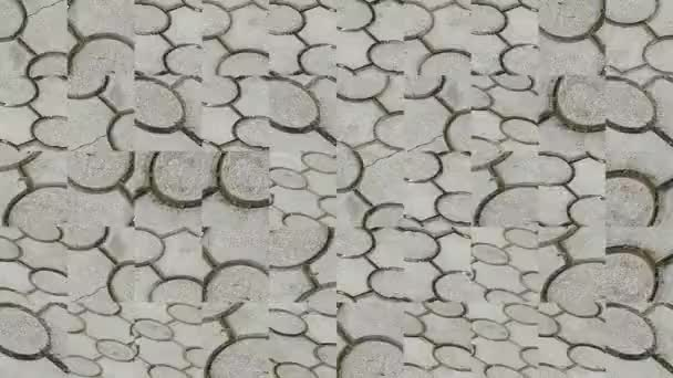 Abstract video of mosaic textures from sidewalk fragments in a gray cement tile. Background design. Backdrop. Wallpaper.