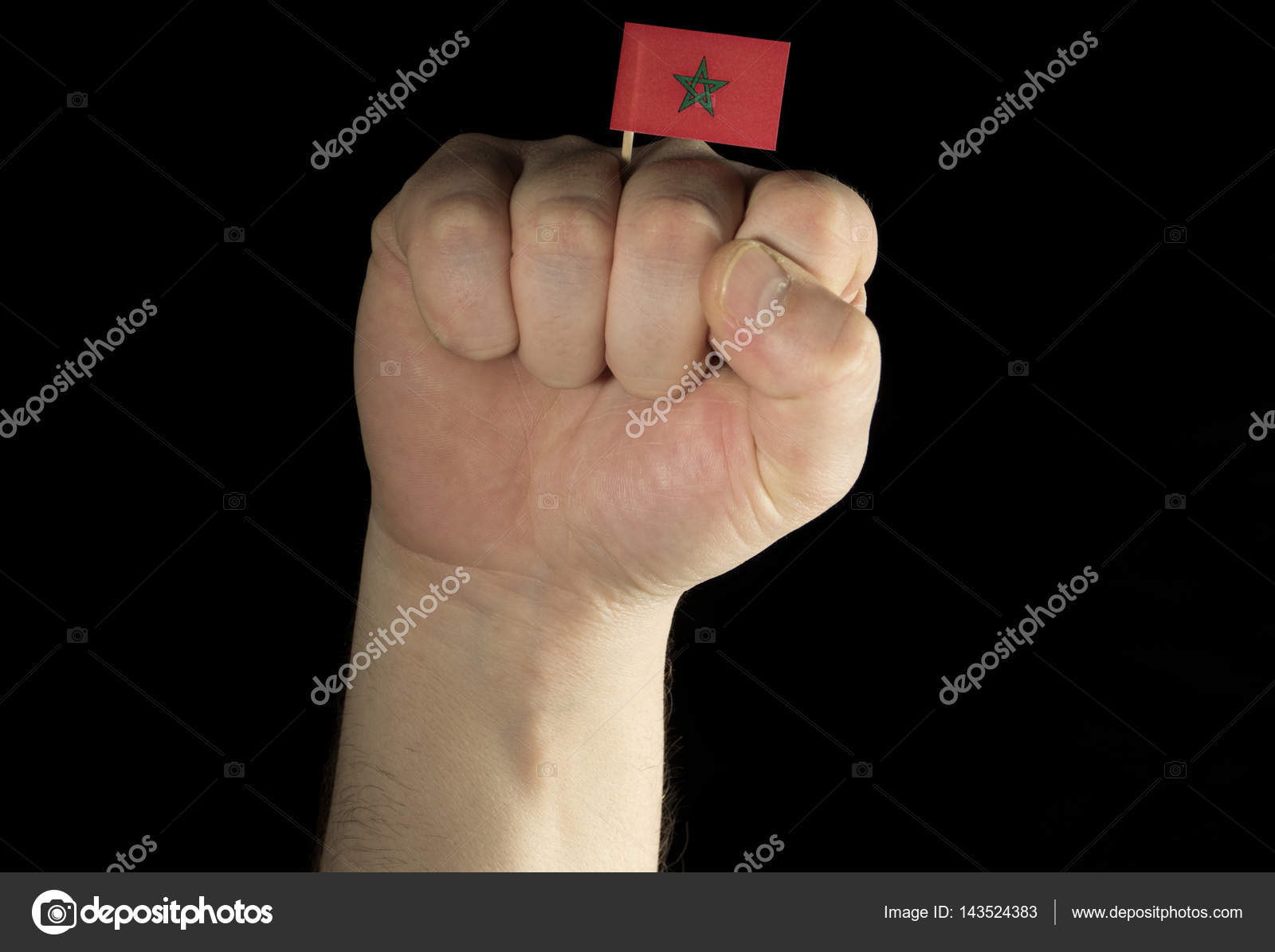 Man Hand Fist With Moroccan Flag Isolated On Black Background