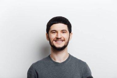 "Картина, постер, плакат, фотообои ""Portrait of young smiling man on white background."", артикул 348847076"