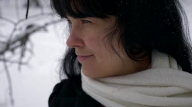 Young Beautiful Woman Smiling. Falling Snowflakes. Winter Snowfall