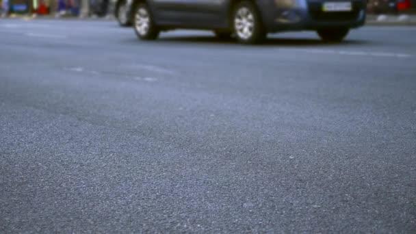 Close-up Cars Wheels On Asphalt Road. City Street.Transport Vehicles