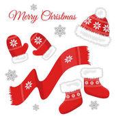 Sada čepice, rukavice, vánoční ponožky, cukroví a sněhové vločky na bílém pozadí. Umělecké předměty
