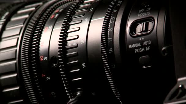 Professional camcorder lens on dark background, macro