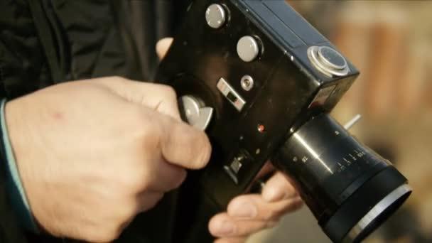 Man the cameraman shoots film vintage 8mm film movie camera