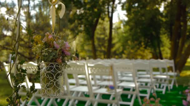 white wooden chairs wedding aisle decor outdoors wedding ceremony