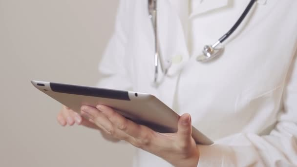 Closeup of doctor using digital tablet