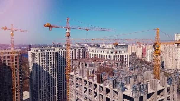 View of the construction site, top floor against the backdrop of the city and working builders