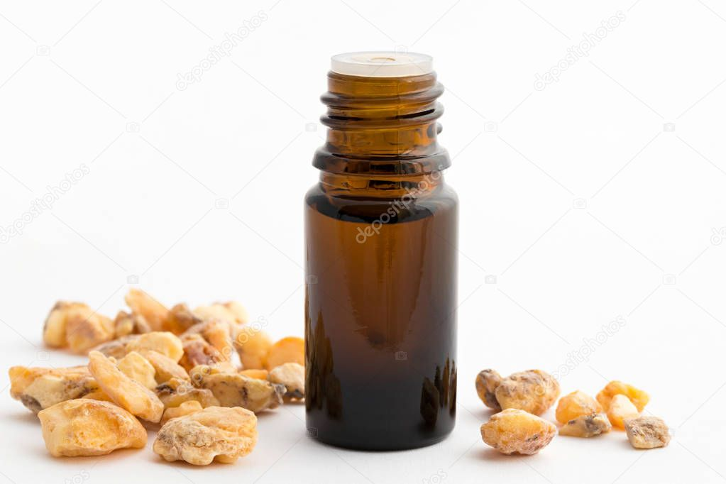 A bottle of styrax benzoin essential oil with benzoin resin