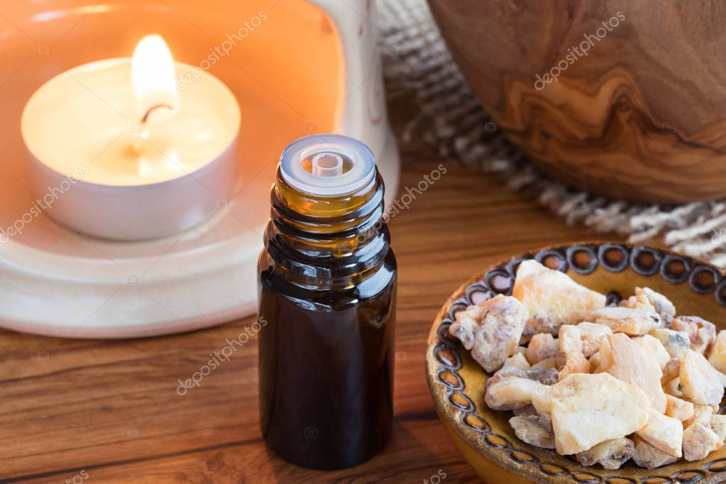 A bottle of styrax benzoin essential oil with benzoin resin and