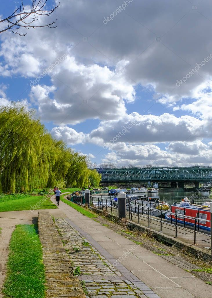 Towpath with joggers by River Lea, Bow
